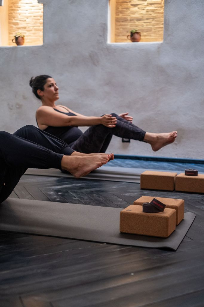 Patricia Lorenzo, yoga teacher in Marrakesh, in a boat pose or navasana, during a group class at the Flow Yoga Studio.